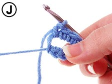 Pull yarn tail to close ring.